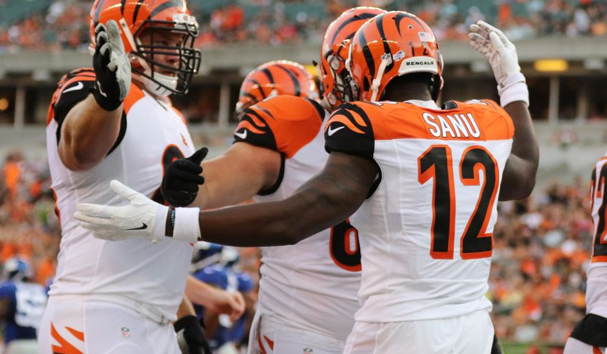 Cincinnati Bengals wide receiver Mohamed Sanu (12) celebrates his touchdown with guard Kevin Zeitler, left, and center Russell Bodine during the first half of an NFL preseason football game against the New York Giants in Cincinnati, Friday, Aug. 14, 2015.  (AP Photo/Gary Landers)