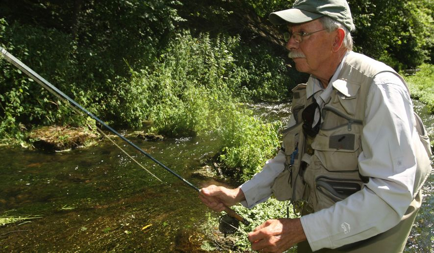 ADVANCE FOR USE MONDAY, AUG. 17 - In this photo taken July 30, 2015, Mark Reisetter, of Lewiston, Minn., who took to flyfishing nearly daily after he got back from serving in Vietnam in the 1970s, fishes south of Lewiston, Minn. He found refuge in the calming rippling of riffles and in the joy of being outdoors. (John Weiss/The Rochester Post-Bulletin via AP) MANDATORY CREDIT