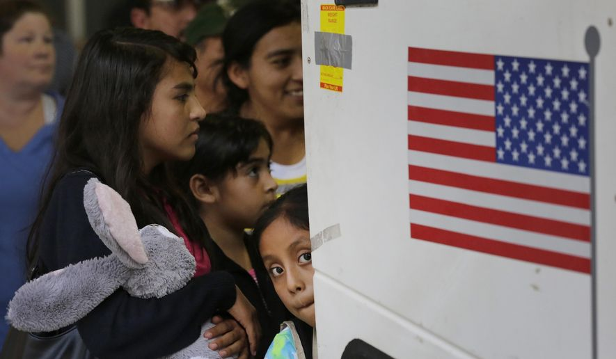 Immigrants from El Salvador and Guatemala who entered the country illegally board a bus after they were released from a family detention center in San Antonio, in this July 7, 2015, file photo. (AP Photo/Eric Gay, File)