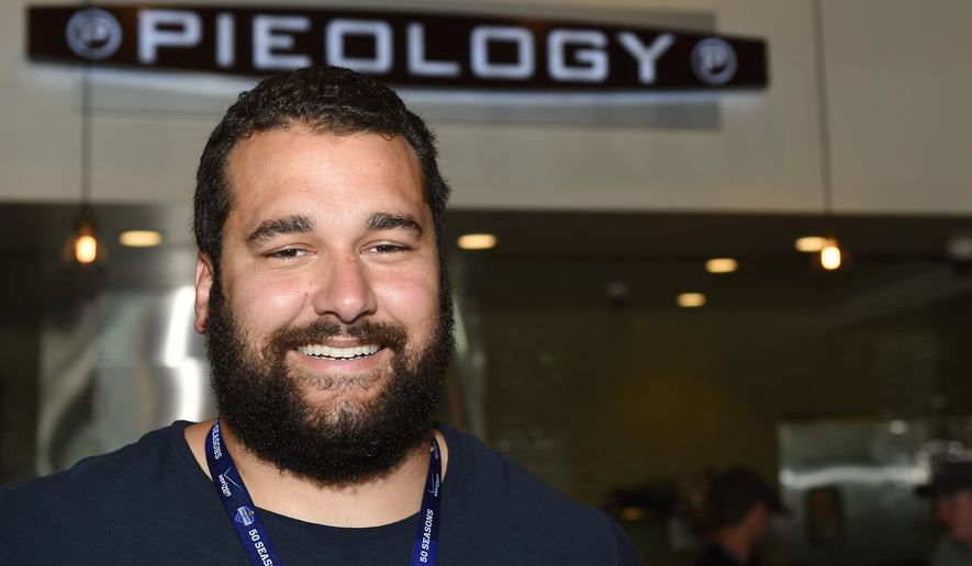 ADVANCE FOR USE MONDAY, AUG. 17 - In this photo taken July 28, 2015, Minnesota Vikings NFL football player Matt Kalil smiles as he poses for a photo in his Pieology, a pizza restaurant that he owns along with his dad, near Minnesota State University, Mankato in Mankato, Minn. (John Autey/Pioneer Press via AP)  MINNEAPOLIS STAR TRIBUNE OUT; MANDATORY CREDIT