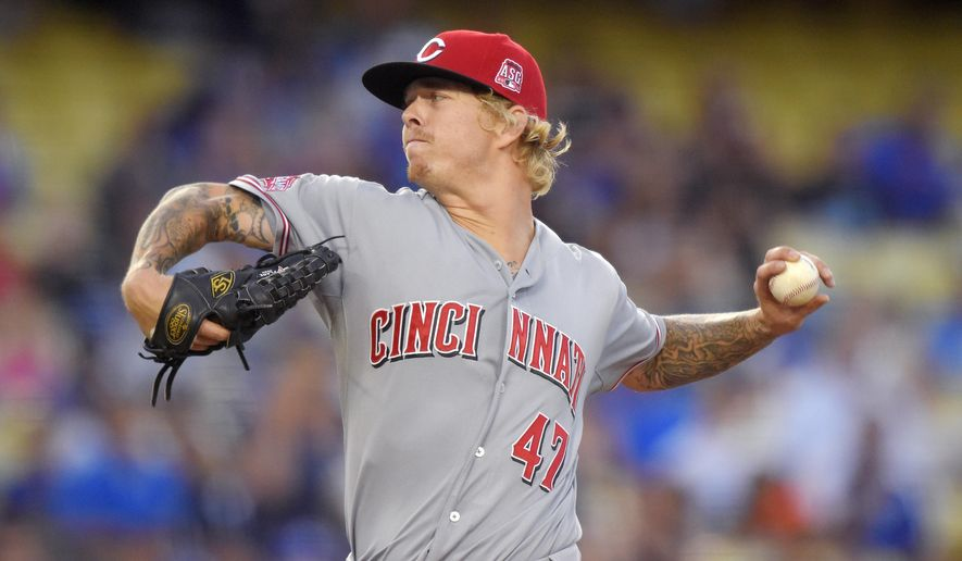 Cincinnati Reds starting pitcher John Lamb throws to the plate during the first inning of a baseball game against the Los Angeles Dodgers, Friday, Aug. 14, 2015, in Los Angeles. (AP Photo/Mark J. Terrill)