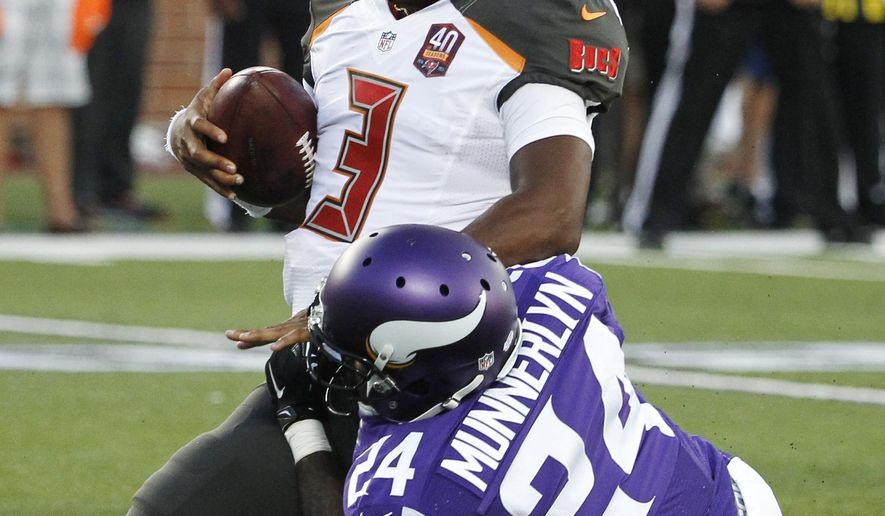 Tampa Bay Buccaneers quarterback Jameis Winston (3) is brought down by Minnesota Vikings cornerback Captain Munnerlyn (24) during the first half of a preseason NFL football game Saturday, Aug. 15, 2015, in Minneapolis. (AP Photo/Ann Heisenfelt)