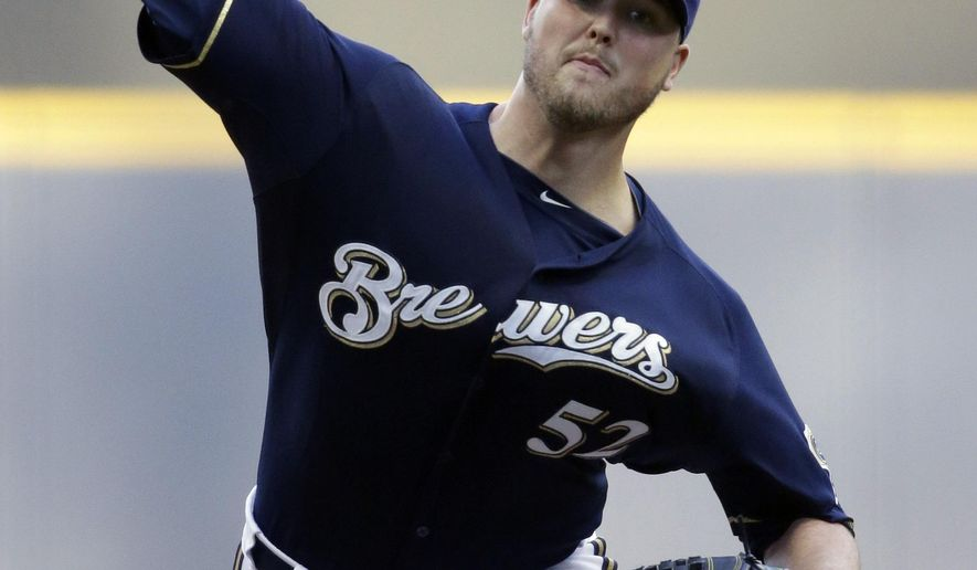 Milwaukee Brewers starting pitcher Jimmy Nelson throws to the Philadelphia Phillies during the first inning of a baseball game Saturday, Aug. 15, 2015, in Milwaukee. (AP Photo/Jeffrey Phelps)