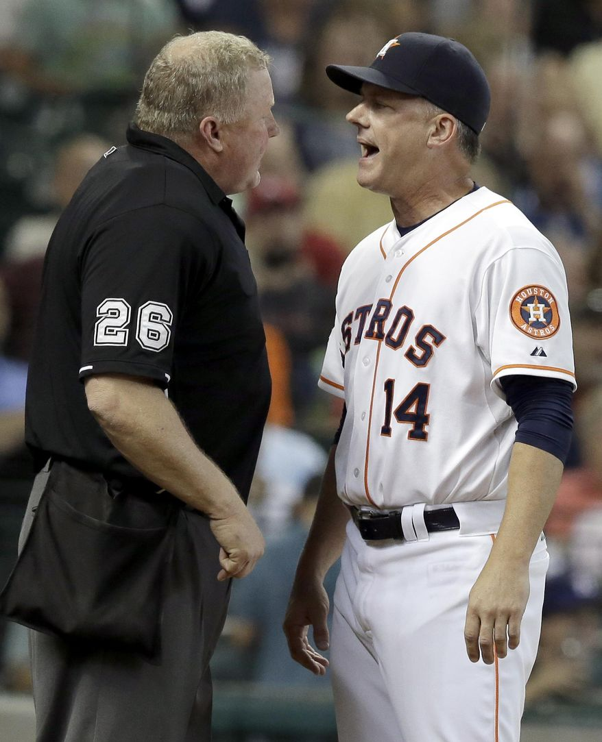 Houston Astros manager A.J. Hinch (14) argues with home plate umpire Bill Miller (26) about a call the fifth inning of a baseball game against the Detroit Tigers on Saturday, Aug. 15, 2015, in Houston. Hinch was ejected from the game. (AP Photo/Pat Sullivan)