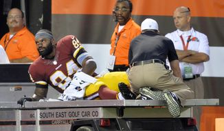 In this Aug. 13, 2015, photo, Washington Redskins tight end Niles Paul leaves on a cart during the first quarter after an injury during an NFL preseason football game against the Cleveland Browns in Cleveland.  At this point, Jordan Reed, whose biggest flaw so far has been an inability to stay on the field, is the healthiest experienced tight end the Washington Redskins have, and even he's dealing with a bad hamstring. (AP Photo/David Richard)