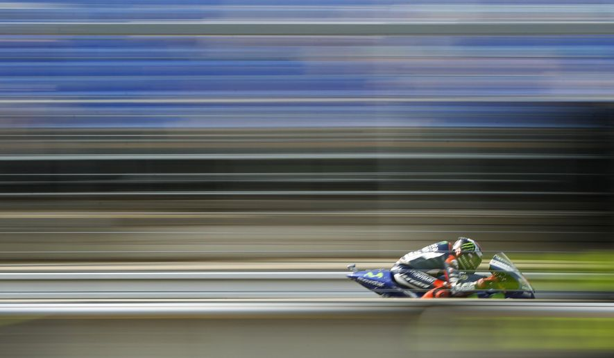 Yamaha rider Jorge Lorenzo from Spain speeds his motorcycle during the third MotoGP free practice prior to the Moto GP race at the Masaryk circuit in Brno, Czech Republic, Saturday, Aug. 15, 2015. The Motorcycle Grand Prix of the Czech Republic is scheduled for Sunday Aug. 16, 2015. (AP Photo/Petr David Josek)