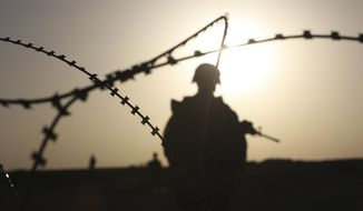 In this Wednesday, Sept. 30, 2009 file photo, U.S. Marines patrol the Nawa district, Helmand province, southern Afghanistan. (AP Photo/Brennan Linsley)
