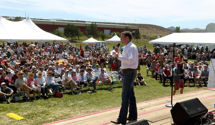 Nevada Attorney General Adam Paul Laxalt gives the welcoming remarks at the Inaugural Basque Fry at the Inaugural Basque Fry at Corley Ranch in Gardnerville, Nev. (AP Photo/Lance Iversen)