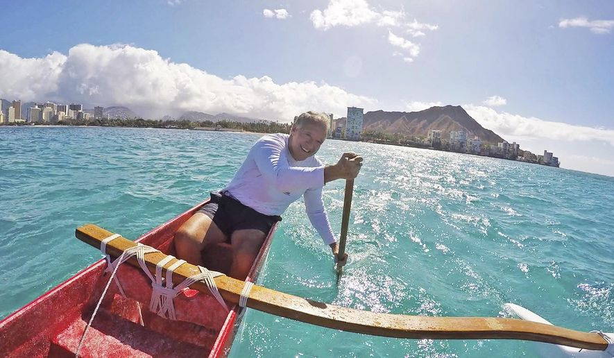 ADVANCE FOR SUNDAY AUG. 16, 2025 AND THEREAFTER - In this Monday, Aug. 3, 2015 photo, Fred Hemmings paddles near the spot where Duke Kahanamoku began his famous one-mile ride outside the Outrigger Canoe Club in Honolulu, Hawaii.  In 1917, Kahanamoku caught a wave near the location and surfed for more than a mile on a 16-foot-long, 114-pound redwood board without a skeg. He told a journalist years later that the wave could have been 30 feet high. (Jamm Aquino/The Honolulu Star-Advertiser via AP).