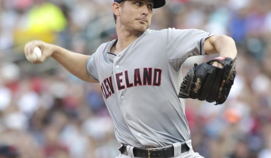 Cleveland Indians starting pitcher Josh Tomlin (43) delivers against the Minnesota Twins during the first inning of a baseball game Saturday, Aug. 15, 2015, in Minneapolis.  (AP Photo/Paul Battaglia)