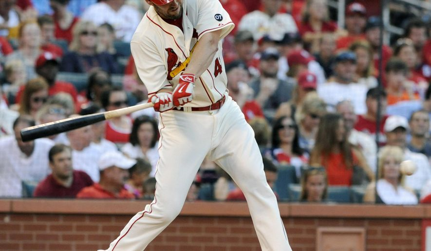 St. Louis Cardinals' starting pitcher John Lackey (41) swings with an RBI single against the Miami Marlins in the second inning of a baseball game, Saturday, Aug. 15, 2015, at Busch Stadium in St. Louis. (AP Photo/Bill Boyce)