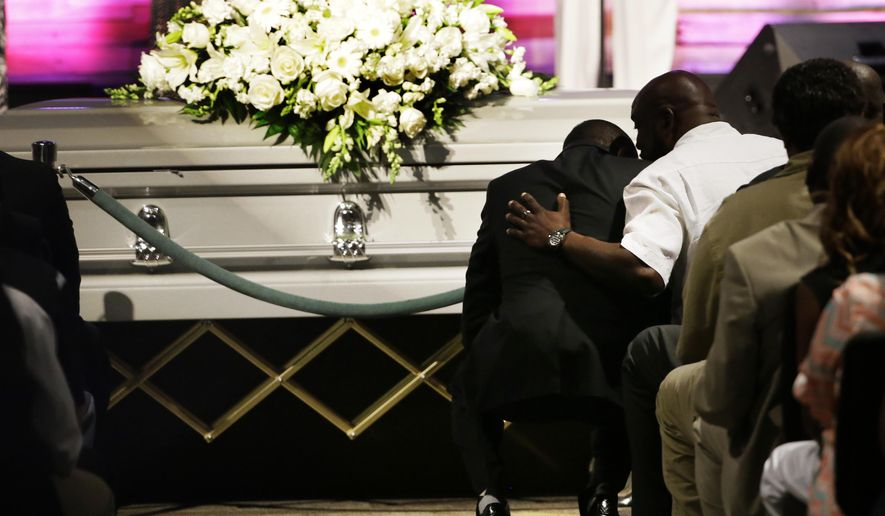 Pastor Ronnie Goines, left, leans in to listen to Adrian Taylor, father of Christian Taylor, during funeral services for Christian at the Koinonia Christian Church in Arlington, Texas, Saturday, Aug. 15, 2015. Taylor was unarmed when he was fatally shot Aug. 7 by an Arlington police officer responding to an after-hours burglary call. The rookie police officer who shot the Angelo State University student was fired Tuesday. (AP Photo/LM Otero)