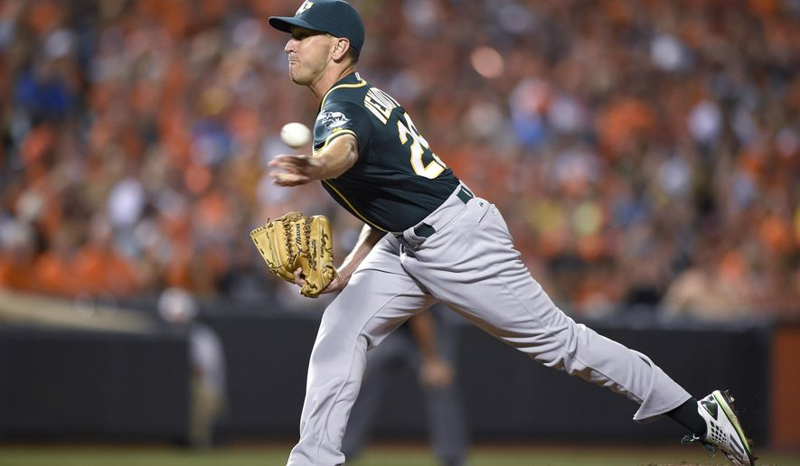 Oakland Athletics reliever Pat Venditte delivers a pitch against the Baltimore Orioles during the ninth inning of a baseball game, Saturday, Aug. 15, 2015, in Baltimore. The Orioles won 4-3. (AP Photo/Nick Wass)