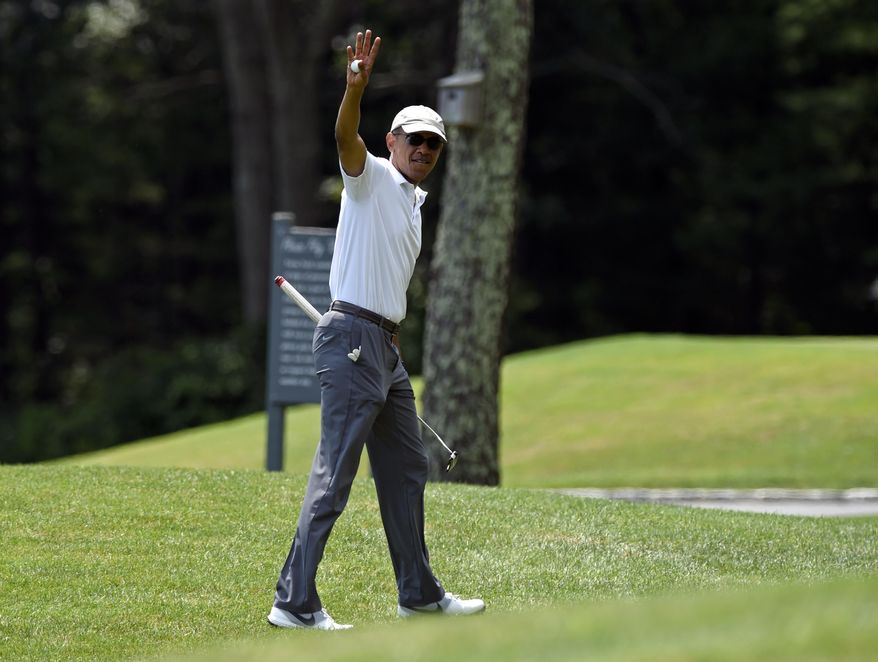 President Barack Obama waves as he plays plays golf on the first hole at Farm Neck Golf Club in Oak Bluffs, Mass., on Martha's Vineyard, Saturday, Aug. 15, 2015. Obama and his family vacation every August on Martha's Vineyard, and he's been spending most of this year's two-week trip on the golf course, at the beach and dining at the island's upscale restaurants.(AP Photo/Susan Walsh)