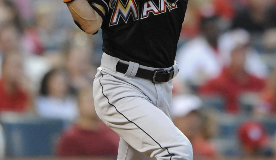 Miami Marlins' Ichiro Suzuki (51) flies out to left against the St. Louis Cardinals in the fifth inning of a baseball game, Saturday, Aug. 15, 2015, at Busch Stadium in St. Louis. (AP Photo/Bill Boyce)