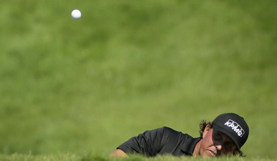Phil Mickelson hits on the 18th hole during the third round of the PGA Championship golf tournament Saturday, Aug. 15, 2015, at Whistling Straits in Haven, Wis. (AP Photo/Chris Carlson)