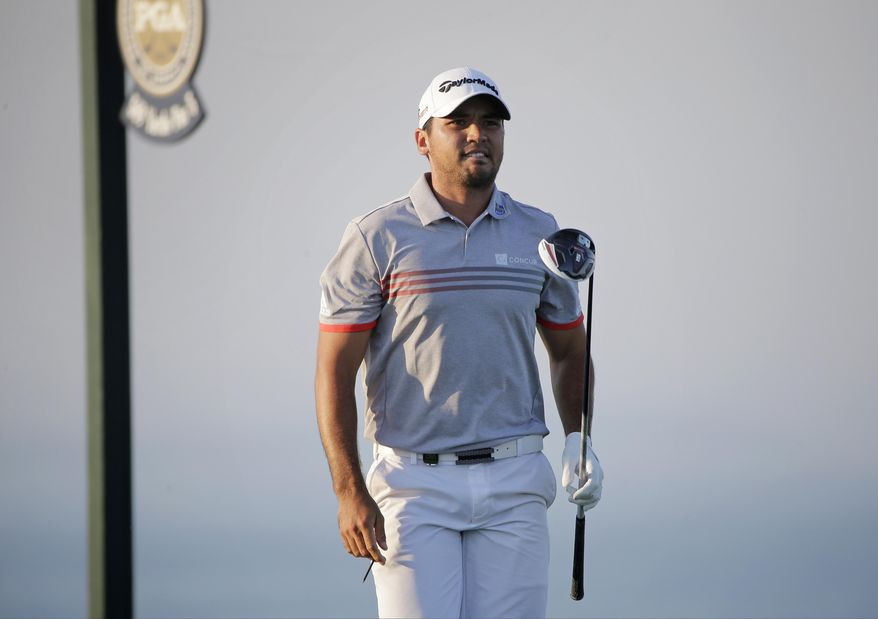 Jason Day, of Australia, watches his shot on the 16th hole during the third round of the PGA Championship golf tournament Saturday, Aug. 15, 2015, at Whistling Straits in Haven, Wis. (AP Photo/Jae Hong)