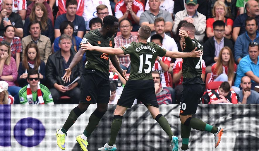 Everton's Romelu Lukaku, left, celebrates with teammates Tom Cleverley, centre, and Ross Barkley, after scoring his sides second goal of the game during the English Premier League soccer match at St Mary's, Southampton, England, Saturday Aug. 15, 2015. (Andrew Matthews/PA via AP)  UNITED KINGDOM OUT  NO SALES  NO ARCHIVE