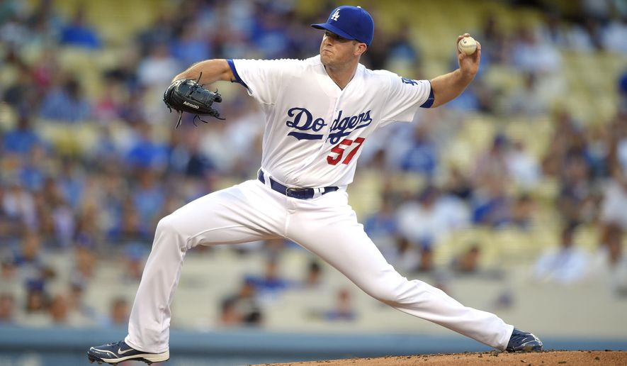 Los Angeles Dodgers starting pitcher Alex Wood throws during the first inning of a baseball game against the Cincinnati Reds, Friday, Aug. 14, 2015, in Los Angeles. (AP Photo/Mark J. Terrill)
