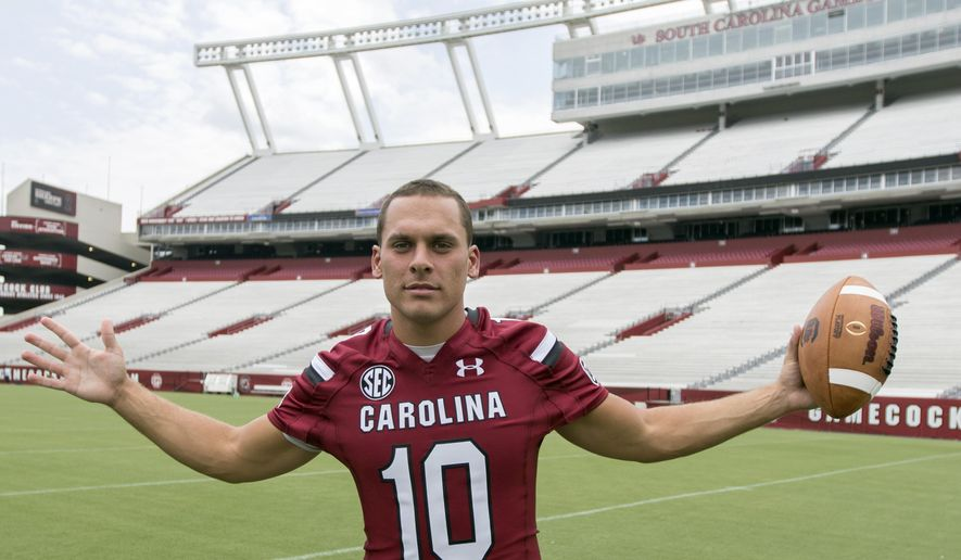 South Carolina quarterback Perry Orth poses for a photograph during NCAA college football media day in Columbia, S.C., Sunday, Aug. 9, 2015. (AP Photo/Stephen B. Morton)