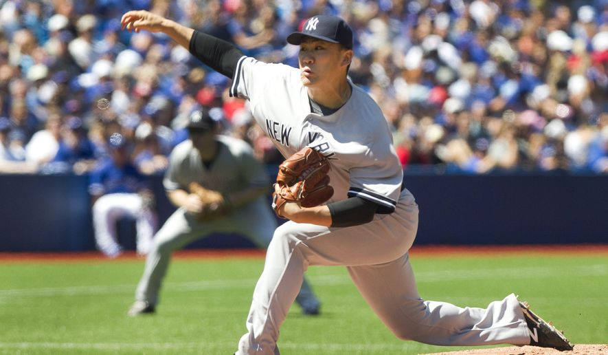 New York Yankees' starting pitcher Masahiro Tanaka throws against the Toronto Blue jays during the second inning of a baseball game in Toronto on Saturday, Aug. 15, 2015. (Fred Thornhill /The Canadian Press via AP) MANDATORY CREDIT