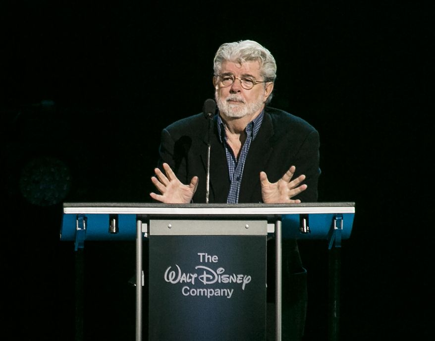 """CORRECTS YEAR TO 2015, NOT 2014 - """"Star Wars"""" creator, filmmaker George Lucas is honored with the Disney Legends Award, Friday, Aug. 14, 2015, in Anaheim, Calif. Lucas sold his company, and his iconic """"Star Wars"""" film franchise, to Disney for $4 billion. (AP Photo/Damian Dovarganes)"""