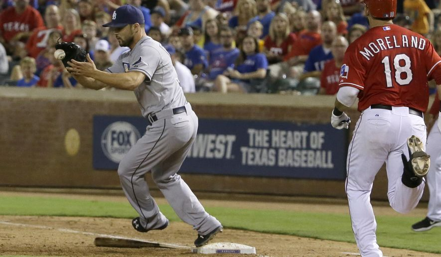 Tampa Bay Rays relief pitcher Xavier Cedeno (31) steps over a broken bat at first base to completes the infield out against Texas Rangers Mitch Moreland (18)  during the sixth inning of a baseball game in Arlington, Texas, Friday, Aug. 14, 2015. The Rangers won 5-3. (AP Photo/LM Otero)
