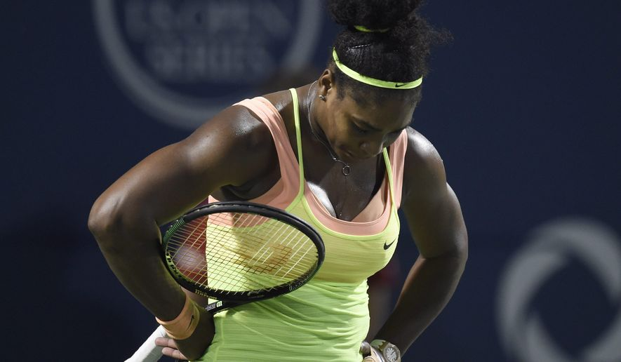 Serena Williams, of the United States, reacts in the third set against Belinda Bencic, of Switzerland, during the Rogers Cup semifinal tennis tournament, Saturday, Aug. 15, 2015 in Toronto. (Frank Gunn/The Canadian Press via AP) MANDATORY CREDIT