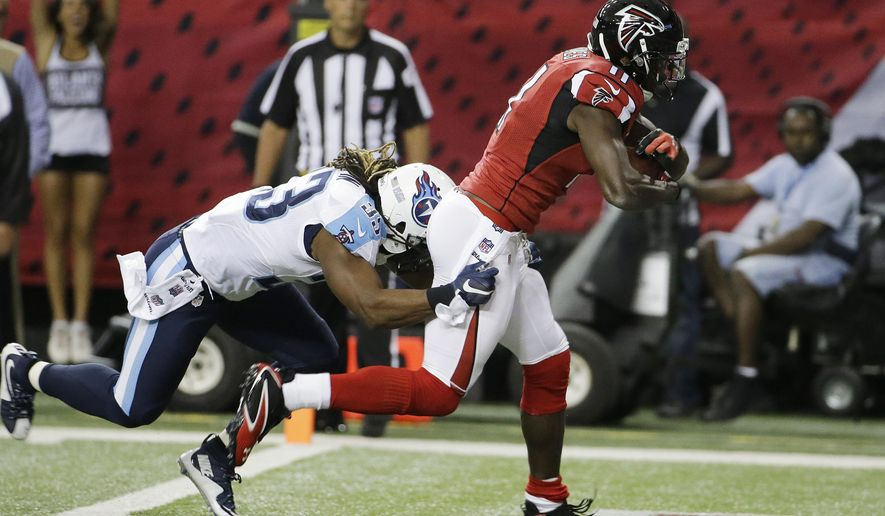Atlanta Falcons wide receiver Julio Jones (11) scores a touchdown as Tennessee Titans free safety Michael Griffin (33) defends during the first half of an NFL football preseason game , Friday, Aug. 14, 2015, in Atlanta. (AP Photo/David Goldman)