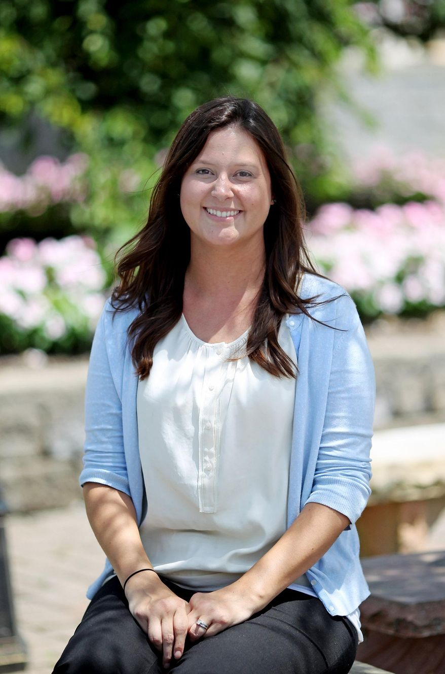 In this July 20, 2015 photo, Kelly Collins, the new CEO of the West Virginia State Fairgrounds, poses for a portrait in Beckley, W.Va. Collins, who has been attending the fair all her life, assumed the position of CEO in March, rising from the interim position she had held since longtime leader Marlene Jolliffe stepped away in January to take a similar spot at the Virginia fair. (Chris Jackson/The Register-Herald via AP) MANDATORY CREDIT
