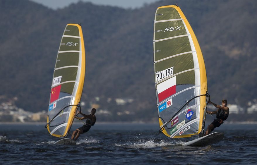 Poland's Pawel Tamowski, right, competes in the RS:X Windsurfer event during a sailing test, ahead of the Rio 2016 Olympic Games, in Guanabara Bay in Rio de Janeiro, Brazil, Saturday, Aug. 15, 2015. (AP Photo/Leo Correa)