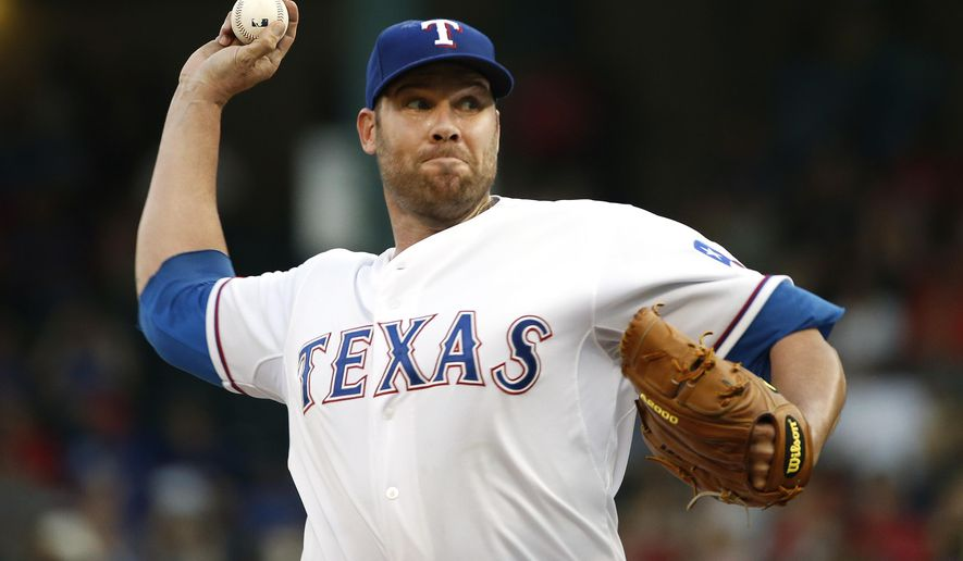 Texas Rangers starting pitcher Colby Lewis delivers during the first inning of a baseball game against the Tampa Bay Rays on Saturday, Aug. 15, 2015, in Arlington, Texas. (AP Photo/Ron Jenkins)