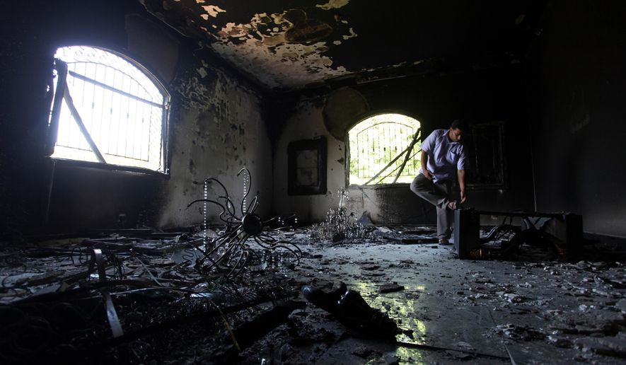FILE - In this Sept. 13, 2012 file photo, a Libyan man investigates the inside of the U.S. Consulate after an attack that killed four Americans, including Ambassador Chris Stevens, on the night of Tuesday, Sept. 11, 2012, in Benghazi, Libya. After Ahmed Abu Khattala was captured in Libya last year to face charges for the Benghazi attacks, he was brought to the U.S. on a 13-day sea trip that his lawyers say should have been done in 13 hours by plane. The prosecution of Abu Khattala is focusing attention again on an interrogation strategy that the Obama administration has used in just a handful of recent terrorism cases.  (AP Photo/Mohammad Hannon, File)
