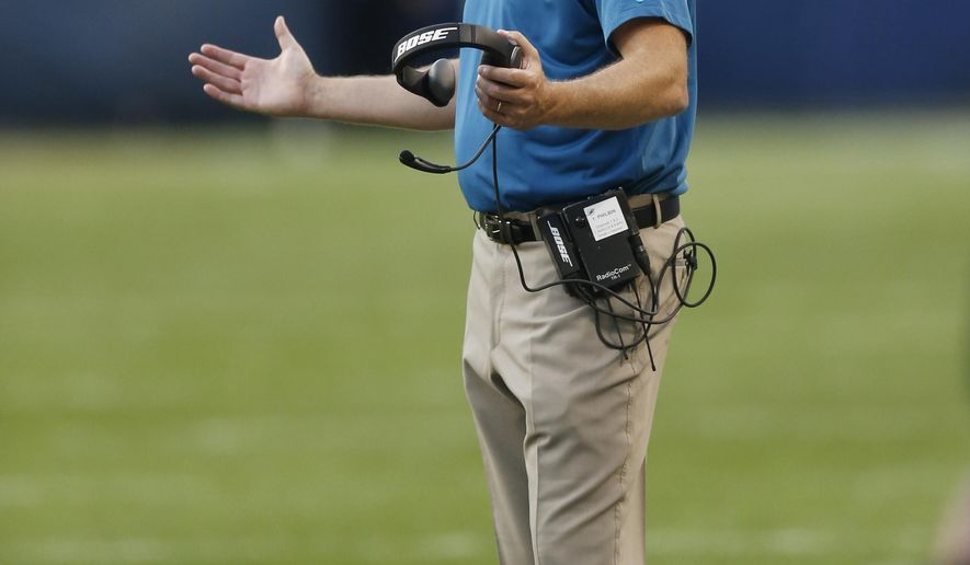 Miami Dolphins head coach Joe Philbin gestures on the sideline during the first half of an NFL preseason football game against the Chicago Bears, Thursday, Aug. 13, 2015, in Chicago. (AP Photo/Charles Rex Arbogast)