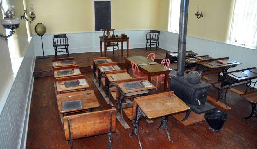 This Tuesday, Aug. 11, 2015, photo, shows the new flooring at the Homestead National Monument of America Freeman School in Beatrice, Neb., replicating what it looked like back in 1970, when the Homestead National Monument of America acquired the one-room schoolhouse. (Jory Schweers/Beatrice Daily Sun via AP) MANDATORY CREDIT