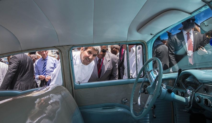 U.S. Secretary of State John Kerry looks into the interior of a classic American car parked in Old Havana, Cuba, Friday, Aug. 14, 2015. Kerry walked in the historic Plaza de San Francisco, stopping to look in shops and greet local residents and store owners. Kerry traveled to the Cuban capital to raise the U.S. flag and formally reopen the long-closed U.S. Embassy. (AP Photo/Ramon Espinosa)