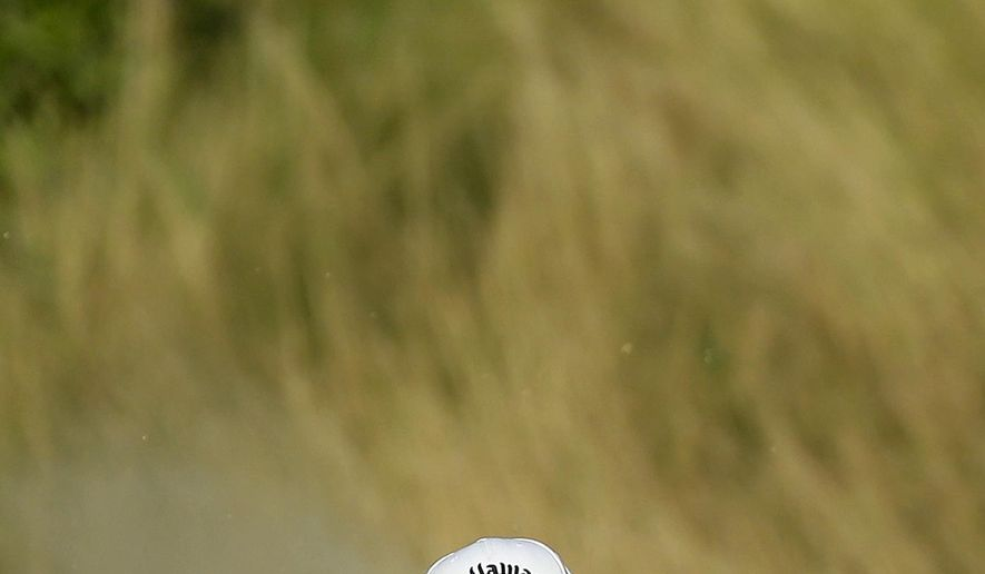 Branden Grace, of South Africa, hits from a bunker on the 18th hole during the third round of the PGA Championship golf tournament Saturday, Aug. 15, 2015, at Whistling Straits in Haven, Wis. (AP Photo/Chris Carlson)