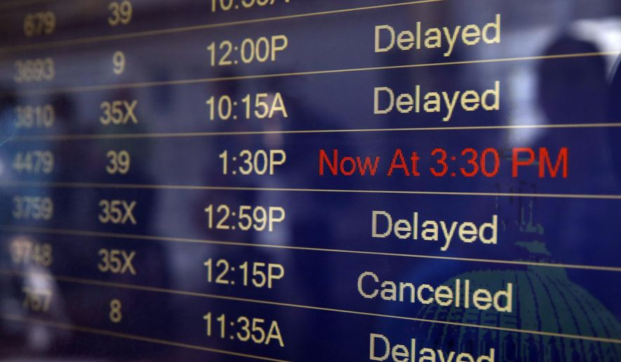 The arrivals and departures board shows the delayed and canceled flights at Washington's Reagan National Airport after technical issues at a Federal Aviation Administration center in Virginia caused delays on Saturday, Aug. 15, 2015. (AP Photo/Jacquelyn Martin)