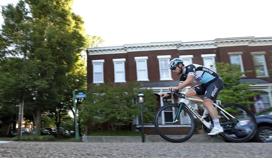 In this May 20,, 2015 photo, professional cyclist Mark Cavendish heads west on East Franklin Street in downtown Richmond, Va., after riding up Libby Hill during his test ride of the 2015 UCI Road World Championships Road Course. The event, featuring 12 Championship races for Elite Men and Women, Under 23 Men and Junior Men and Women, will be held in the Richmond area from September 19 to 27, 2015. (Mark Gormus/Richmond Times-Dispatch via AP)  MANDATORY CREDIT