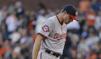 Washington Nationals starting pitcher Max Scherzer stands on the mound after giving up a home run to the San Francisco Giants' Matt Duffy in the first inning of their baseball game Friday, Aug. 14, 2015, in San Francisco. (AP Photo/Eric Risberg)
