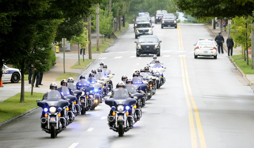 Vice President Joe Biden motorcade arrives at McKenzie Arena in Chattanooga, Tennessee memorial service Saturday, Aug. 15, 2015, in Chattanooga, Tenn. The service is for four Marines and a sailor killed as a result of attacks on a military recruiting station and a Naval operations center July 16 in Chattanooga. (AP Photo/Mark Gilliland)