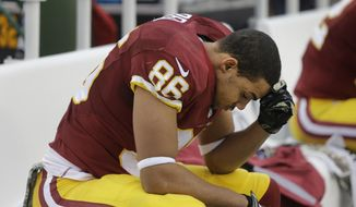 In this Nov. 16, 2014, file photo, Washington Redskins tight end Jordan Reed (86) sits on the bench during the second half of an NFL football game against the Tampa Bay Buccaneers in Landover, Md. (AP Photo/Patrick Semansky) ** FILE **