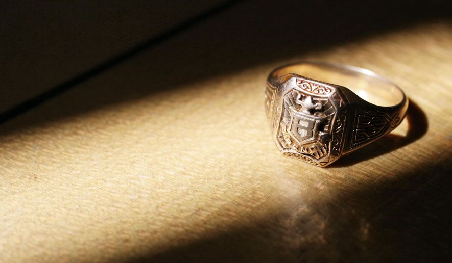 This Aug. 13, 2015 photo shows a 1928 Bend High School class ring at the Des Chutes Historical Museum in Bend, Ore. It found by a snorkeler in Cultus Lake. (The Bulletin via AP) MANDATORY CREDIT