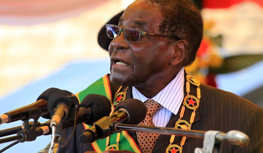 Zimbabwean President Robert Mugabe delivers a speech during a ceremony in Harare, Monday Aug. 10, 2015, honouring thousands of fighters who died in a 1970s Bush war against colonialism. Mugabe, in his first public comments about the popular lion named Cecil, says his compatriots failed in their responsibility to protect the lion that was killed by an American in an allegedly illegal hunt. (AP Photo/Tsvangirayi Mukwazhi)