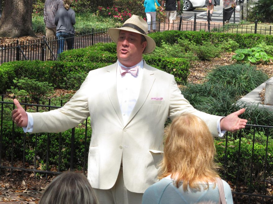 FILE - In this Friday, March 20, 2015 file photo, Dan Leger, who works under the name Savannah Dan, talks with visitors while leading a guided tour of downtown Savannah, Ga. The local government in Savannah requires tour guides to earn a license by passing a 100-question test on Savannah's history, key locations and architecture. A federal lawsuit challenging the licensing law says it violates guides' free-speech rights. (AP Photo/Russ Bynum, File)