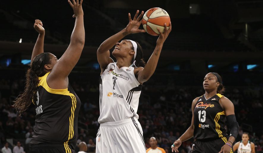 New York Liberty center Avery Warley-Talbert (7) goes to the basket against Tulsa Shock center Courtney Paris (3) during the first half of WNBA basketball game, Saturday, Aug. 15, 2015, at Madison Square Garden in New York. (AP Photo/Mary Altaffer)