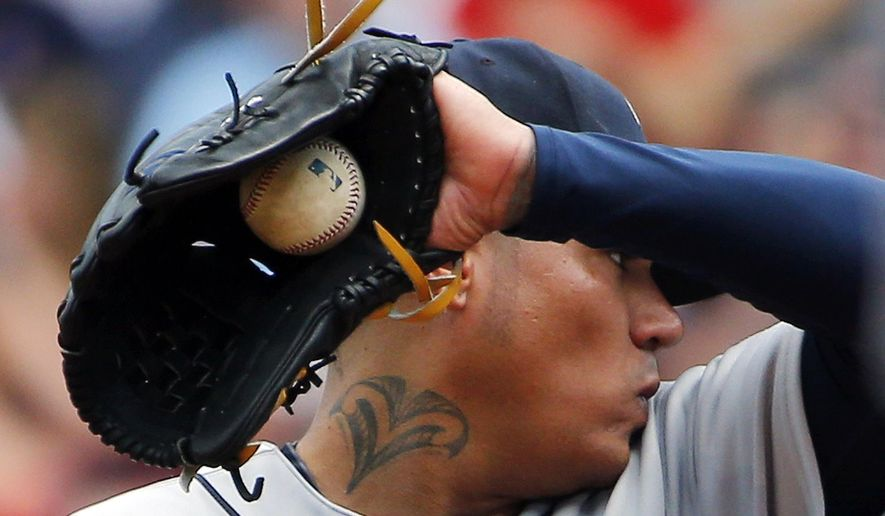 Seattle Mariners starting pitcher Felix Hernandez wipes his face during the third inning of their 22-10 loss to the Boston Red Sox in a baseball game at Fenway Park in Boston Saturday, Aug. 15, 2015.(AP Photo/Winslow Townson)