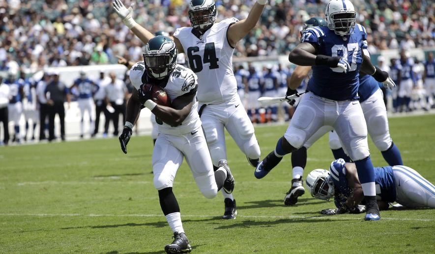 Philadelphia Eagles' Kenjon Barner (34) scores a touchdown during the first half of a preseason NFL football game against the Indianapolis Colts, Sunday, Aug. 16, 2015, in Philadelphia. (AP Photo/Michael Perez)