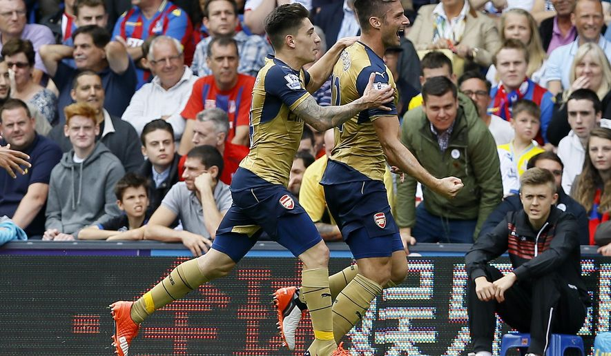 Arsenal's Olivier Giroud, right, celebrates scoring a goal with Hector Bellerini during the English Premier League soccer match between Arsenal and Crystal Palace at Selhurst Park Stadium in London, Sunday, Aug. 16, 2015. (AP Photo/Kirsty Wigglesworth)