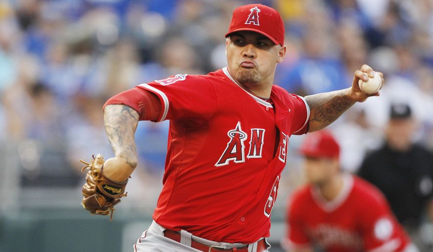 Los Angeles Angels pitcher Hector Santiago delivers during the first inning of a baseball game against the Kansas City Royals at Kauffman Stadium in Kansas City, Mo., Sunday, Aug. 16, 2015. (AP Photo/Colin E. Braley)
